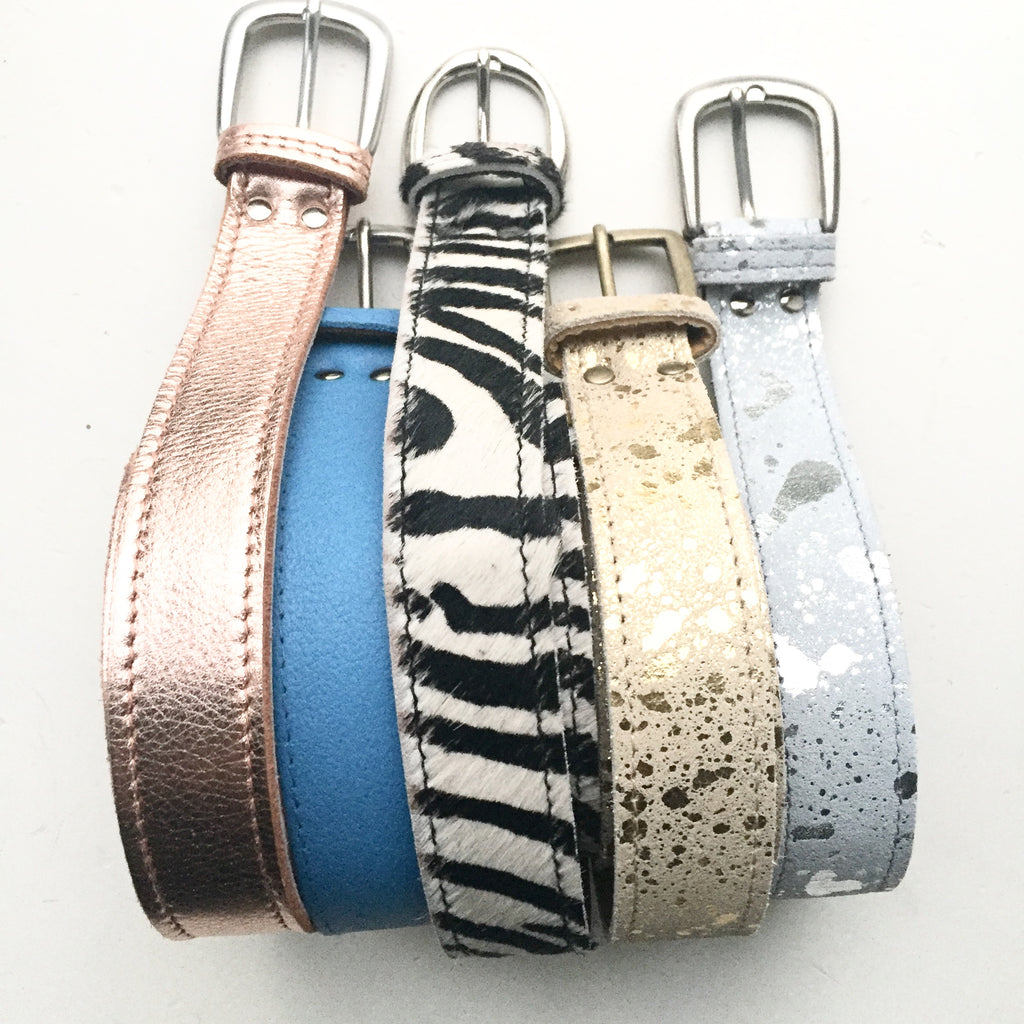 Handmade leather belts in rose gold, gold splash, zebra, silver splash and blue