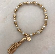 Pearl and gold stretch tassel bracelet