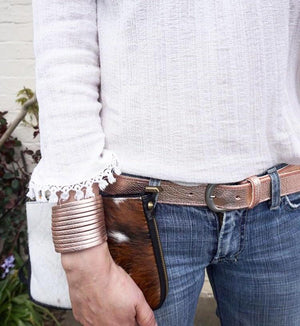 Wide leather cuffs in rose gold