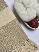 Cotton throws in camel, blue and brown