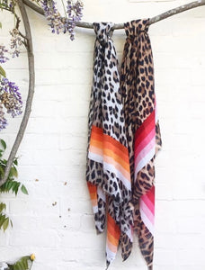 Leopard print scarf with a rainbow of red stripes
