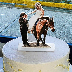 Photo sculpture of bride and groom cake topper on a wedding cake.  Great for table decorations too!