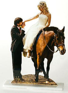 Groom kissing bride's hand while she sits on a horse - Photo cutout cake topper.