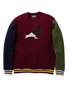 Burgundy body with a half plaid half chenille Staple pigeon logo. right sleeve is navy left sleeve in forrest green