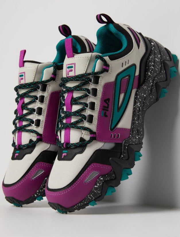 Chunky sole teal and purple accents with tan toe box and leather with teal fila flag