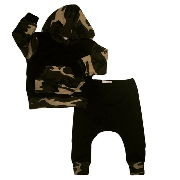 For the little outdoorsman, this adorable 2-piece outfit includes a camouflage hooded top and matching pants.