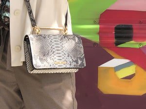 Python creamy evening clutch, cross bag, belt bag, shoulder bag, with its long adjustable handle.  Sizes:  The bag sizes 20 x 12 x 5 Cm, the handle 120 to 134 cm.