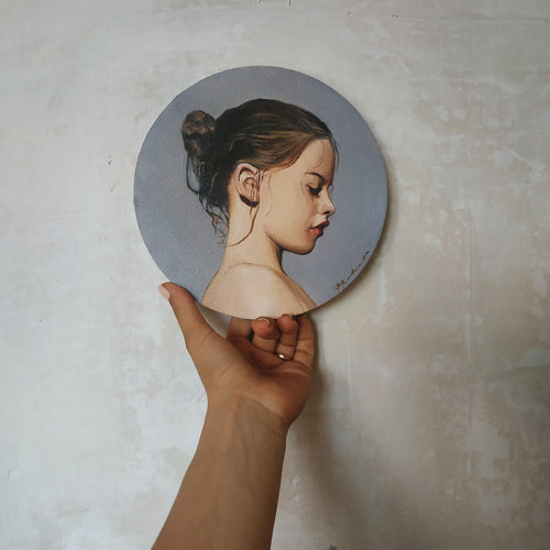 Oil portrait on a round canvas (painted from a photograph)
