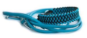 Martingale paracord dog collar in black and cerulean blue with blue leather lead