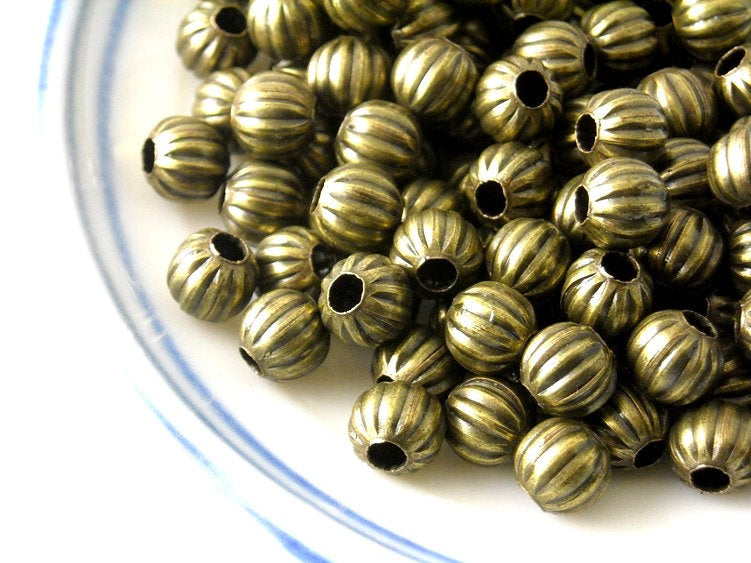 Corrugated Metal Bead in antique bronze, 6mm - 50 pcs