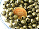 Corrugated Metal Bead in antique bronze, 6mm - 50 pcs - Pim's Jewelry Supplies
