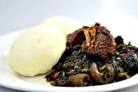 Pounded yam and Vegetable soup