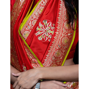 The feeling of wedding, lightweight silk banarasi sari in fiesta red. With hand-embroidered tulip motifs.