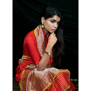 Lightweight silk banarasi sari in fiesta red, with hand-embroidered tulip motifs.