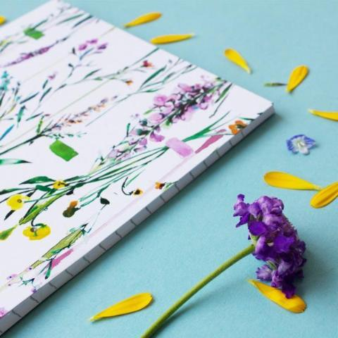 Fleur Botanique notebook lifestyle close up & next to a flower