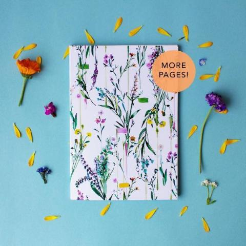 Fleur Botanique notebook lifestyle shot with flowers around it