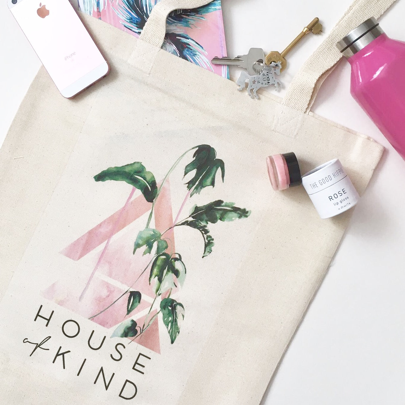 Lifestyle shot of ethical, cotton tote bag with House of Kind logo designed by Nikki Strange