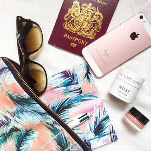 Lifestyle shot of pink, ethical cotton travel pouch with palm leaf design