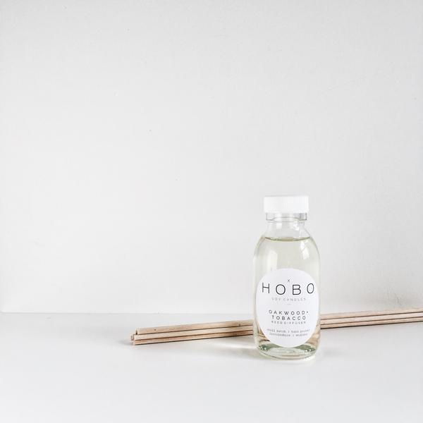 Scandi style room diffuser in glass bottle with reeds - Oakwood and Tobacco