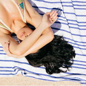 Girl lying on la bahia towel