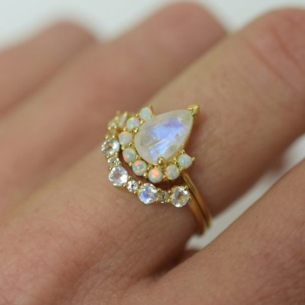 Rainbow Moonstone and Topaz Arc ring stacked with ballerina ring