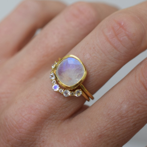 Rainbow Moonstone and Topaz Arc ring stacked with rainbow moonstone eclipse ring