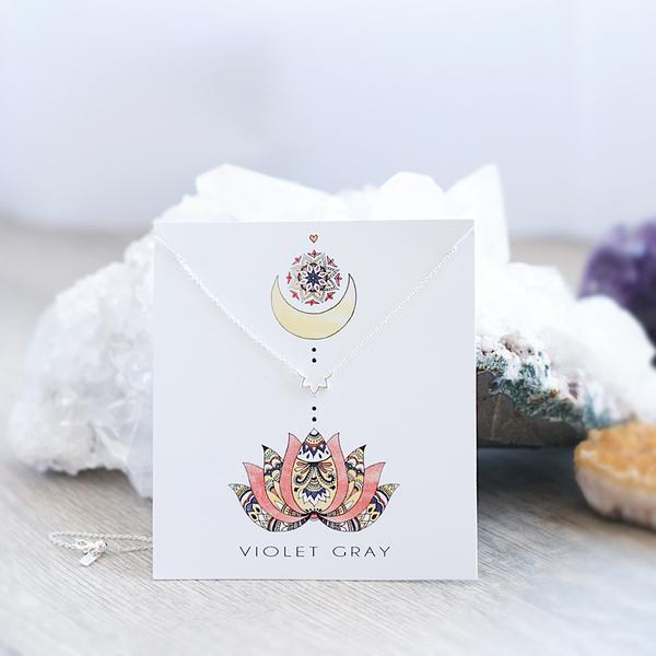 Ethical, sterling silver lotus inspired necklace in packaging