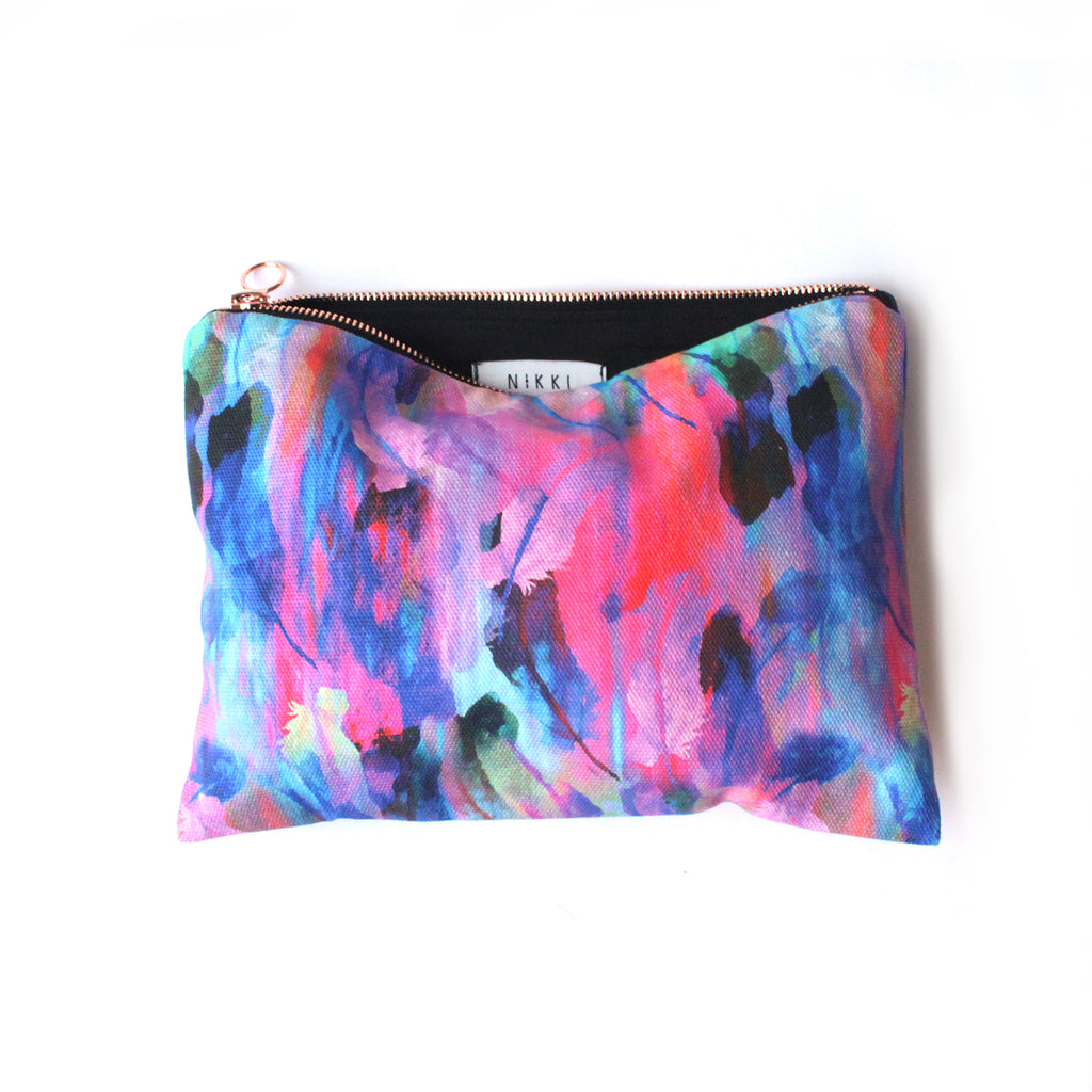 Ethical cotton wash bag/travel pouch with bright feather design