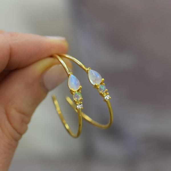 hand holding the Rainbow moonstone, Opal & Topaz Elise Hoops