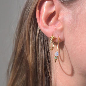 Lifestyle shot of girl wearing the Rainbow moonstone, Opal & Topaz Elise Hoops