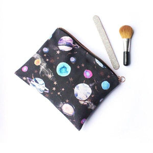 Ethical cotton wash bag/travel pouch with marble galaxy design. Nail file and makeup brush as accessories.