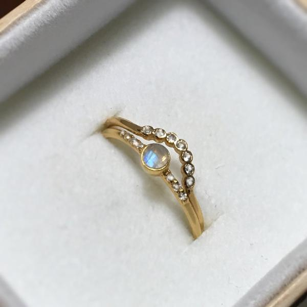 Rainbow Moonstone Galaxy Ring stacked in box with another ring