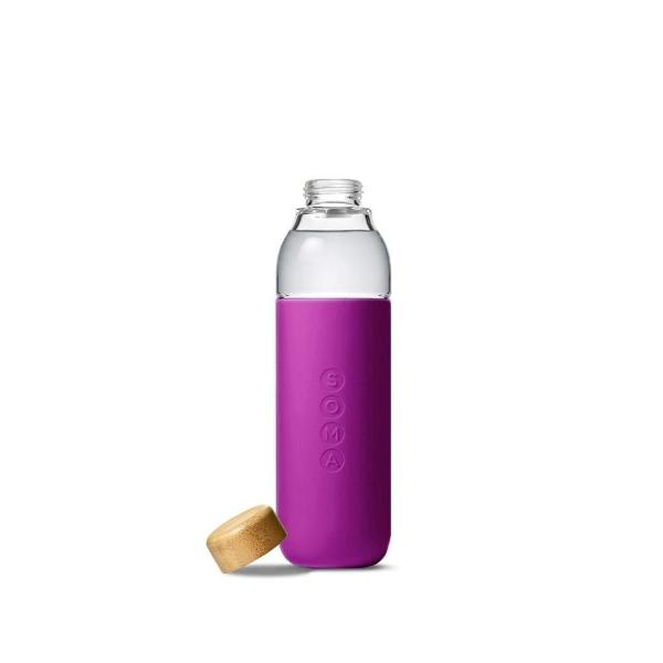 Soma glass water bottle in eggplant silicone wrap with bamboo lid taken off and placed on the side
