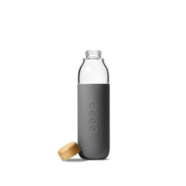 Soma glass water bottle in grey silicone wrap with bamboo lid taken off and placed on the side
