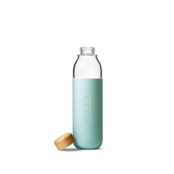 Soma glass water bottle in mint silicone wrap with bamboo lid taken off and placed on the side