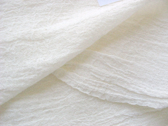 Off white soft wrinkled cotton gauze fabric