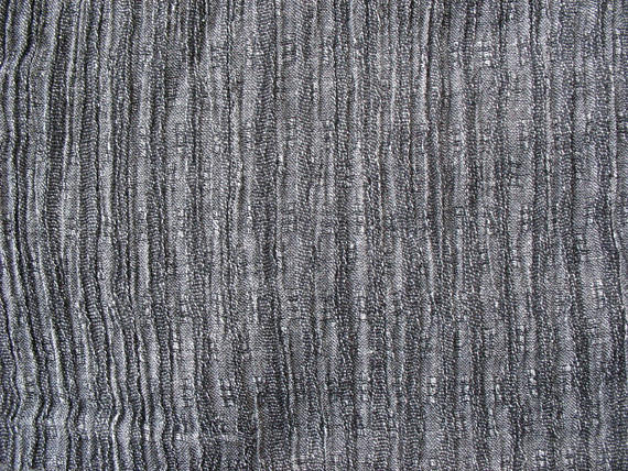 Grey soft wrinkled cotton gauze fabric
