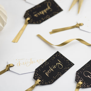 christmas gift tags foiled with ribbon