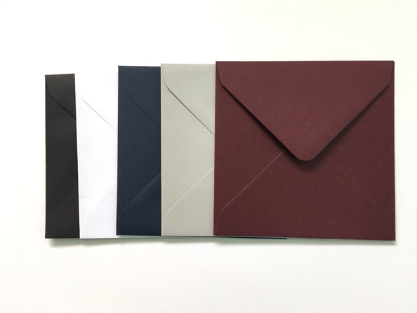 square colour envelopes for save the dates