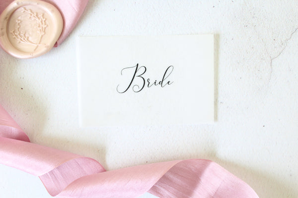 Foiled Vellum Wedding Flat Place Cards personalised with guests names from the Elegance Collection by Confetti Sweethearts
