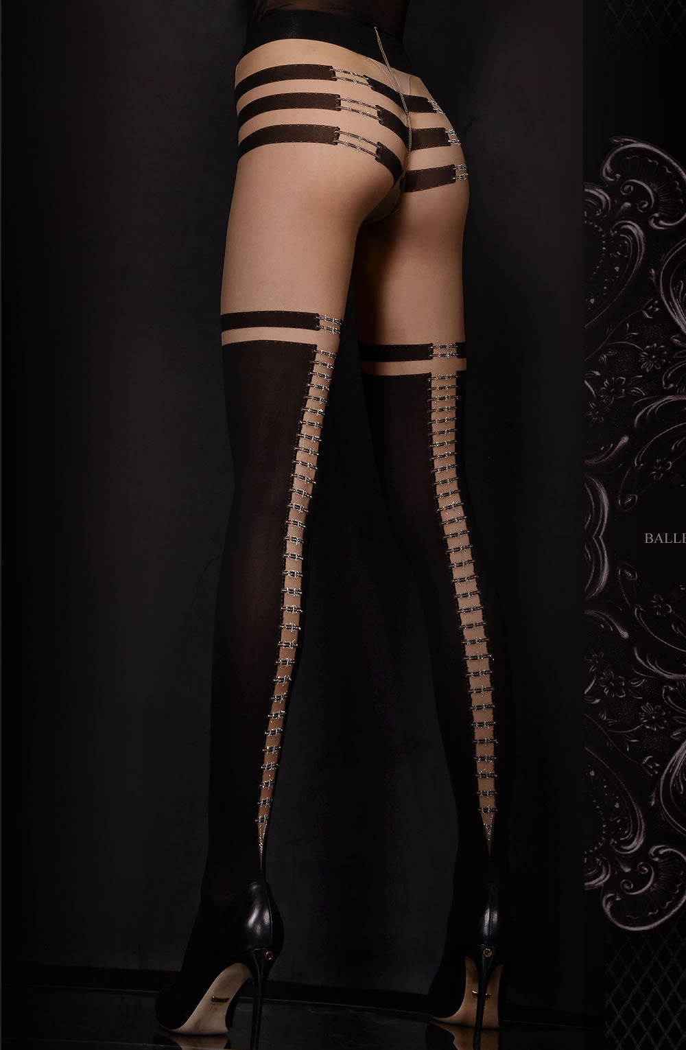 sexy black tights with decorative back seam pattern which is sexy. rear view. by ballerina
