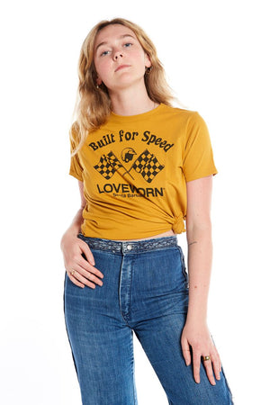 hand screened gold rush built for speed short sleeve crew neck tee shirt and denim jeans