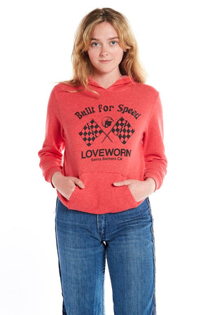 red long sleeve pullover fleece hoodie with built for speed silkscreen and blue denim jeans