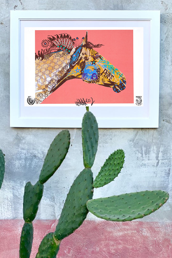 wallace poster electric peace framed on wall with cactus
