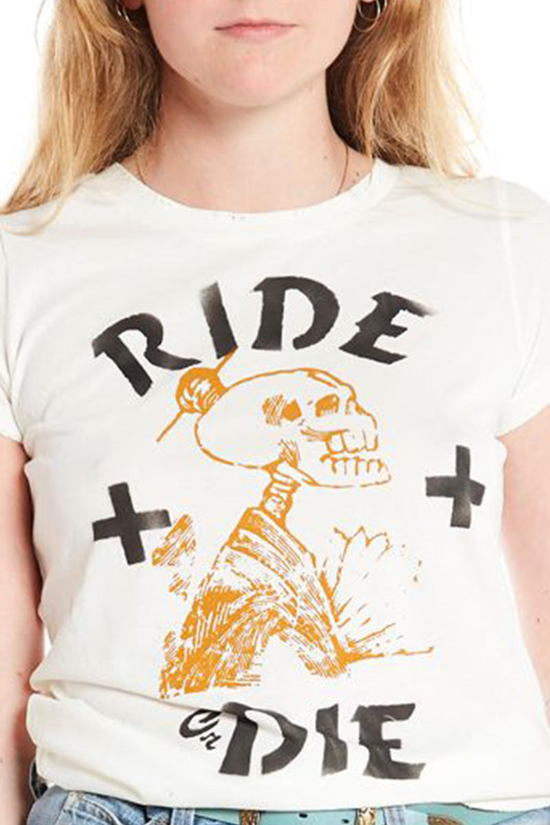 close up of short sleeve cotton crew neck t-shirt with hand screened and stenciled ride or die graphics in black and gold. styled with vintage roebucks denim jeans