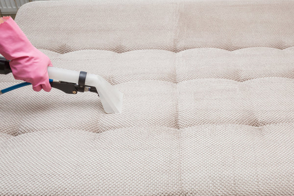 Person cleaning mattress