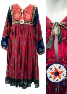 Traditional afghan kuchi dress in burgundy floral printed brushed cotton with beaded embellishments and bell sleeves
