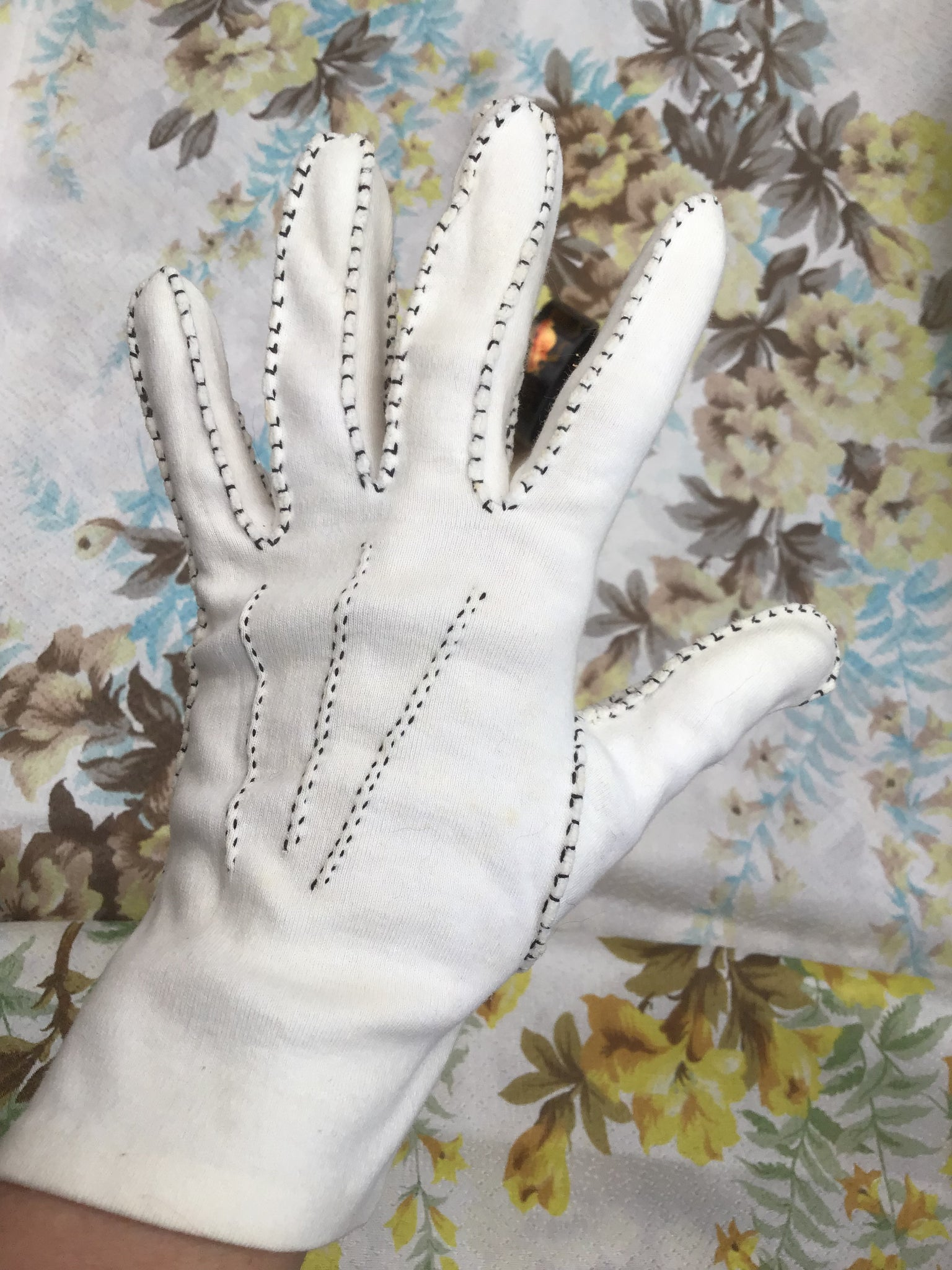 Vintage white cotton gloves, handmade with black contrasting stitching around the seams