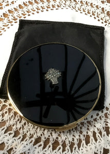 beautiful polished black powder compact case by Stratton with a centred marcasite flower basket  decoration. Fantastic vintage  gift idea