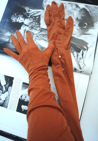 elbow length vintage evening gloves in a rust cinnamon sheer nylon, very rita hayworth glamour gloves.